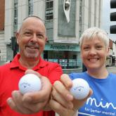 Phil Cooper of Arnolds Keys and Sarah of Norwich Mind celebrate the success of the Arnolds Keys Golf Day
