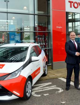 Clive Hedges right of Arnolds Keys and Damian Pavy of Dingles Toyota with one of the new Toyota Aygos