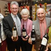 Arnolds Keys wine winners Mr and Mrs Winn second right and centre with Arnolds Keys Cromer office staff