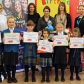 Hethersett Old Hall School pupils receive their certificates from Arnolds Keys