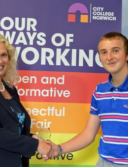 Callum Ellis is congratulated by City College Norwich principal Corinne Peasgood